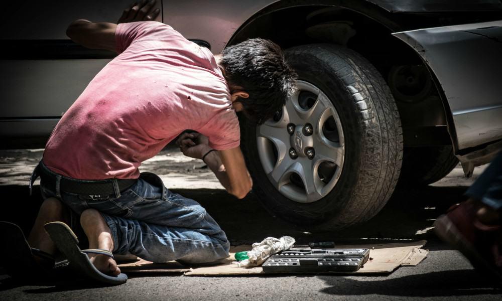 Kid Fixing Car