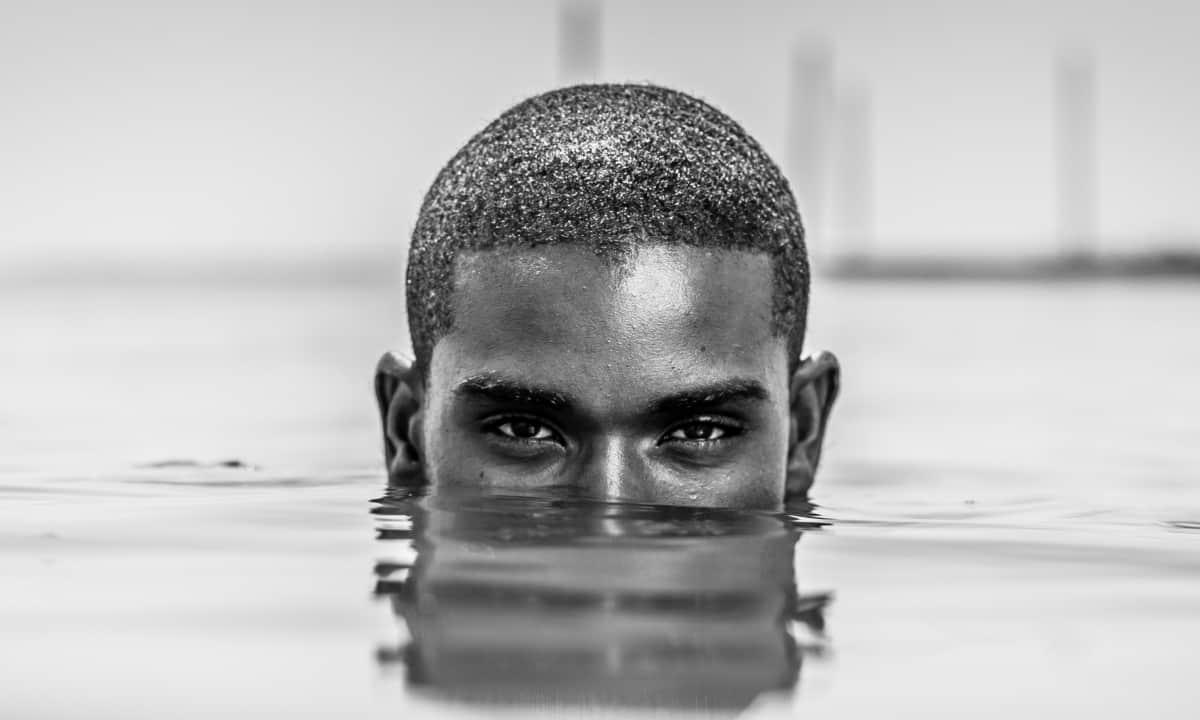 Black man emerging water
