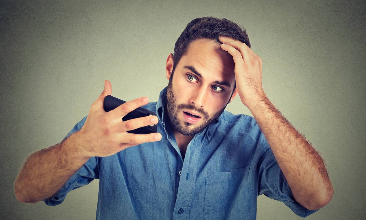 Man Worrying About Hair Loss