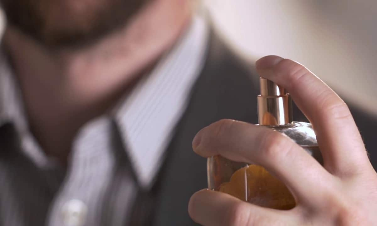 Man Holding Perfume Bottle