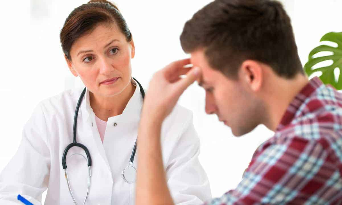 Man Talking to Woman Doctor