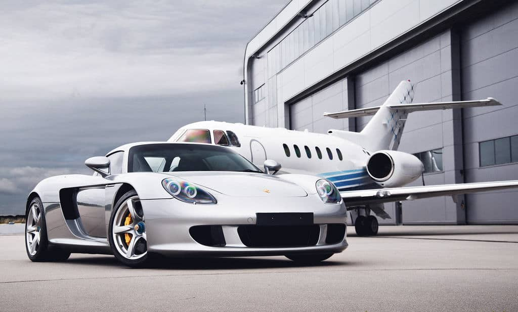 Porsche Carrera GT And Private Jet