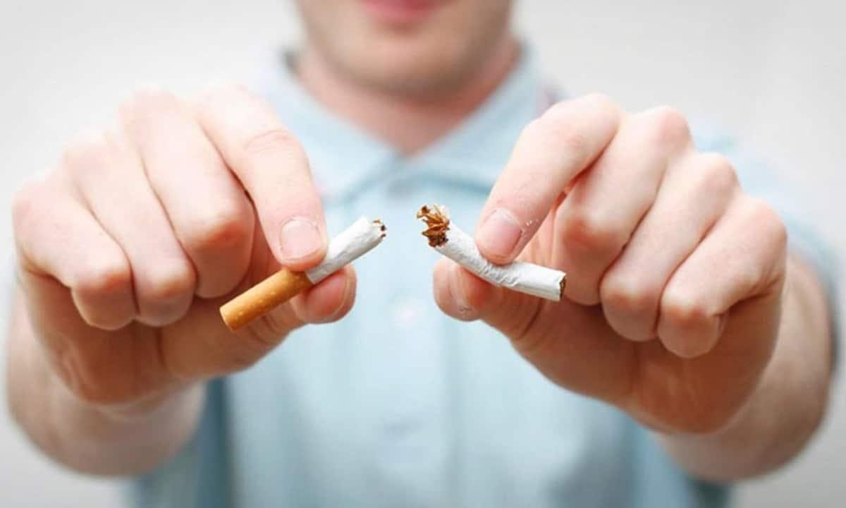 Quit Smoking - man breaking cigarette