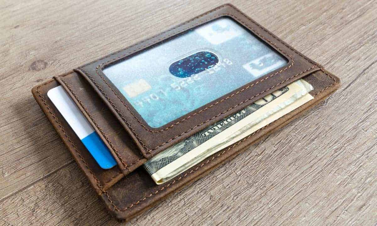leather wallet holding cards, money