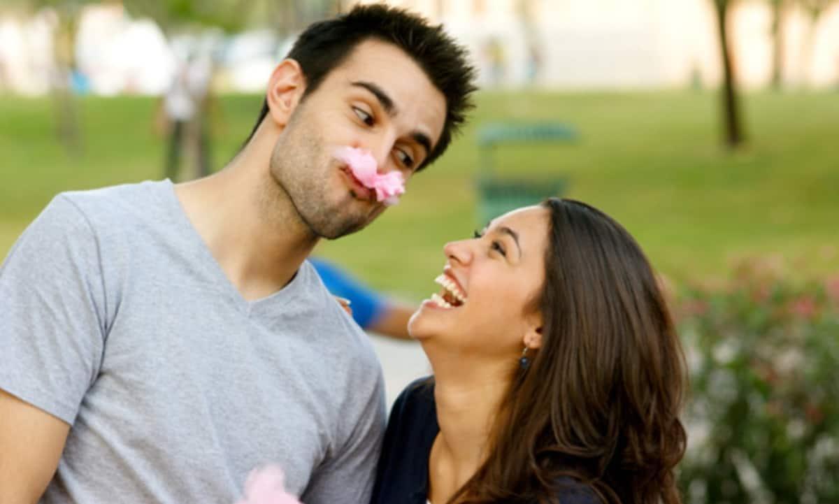 Funny Man making woman laugh