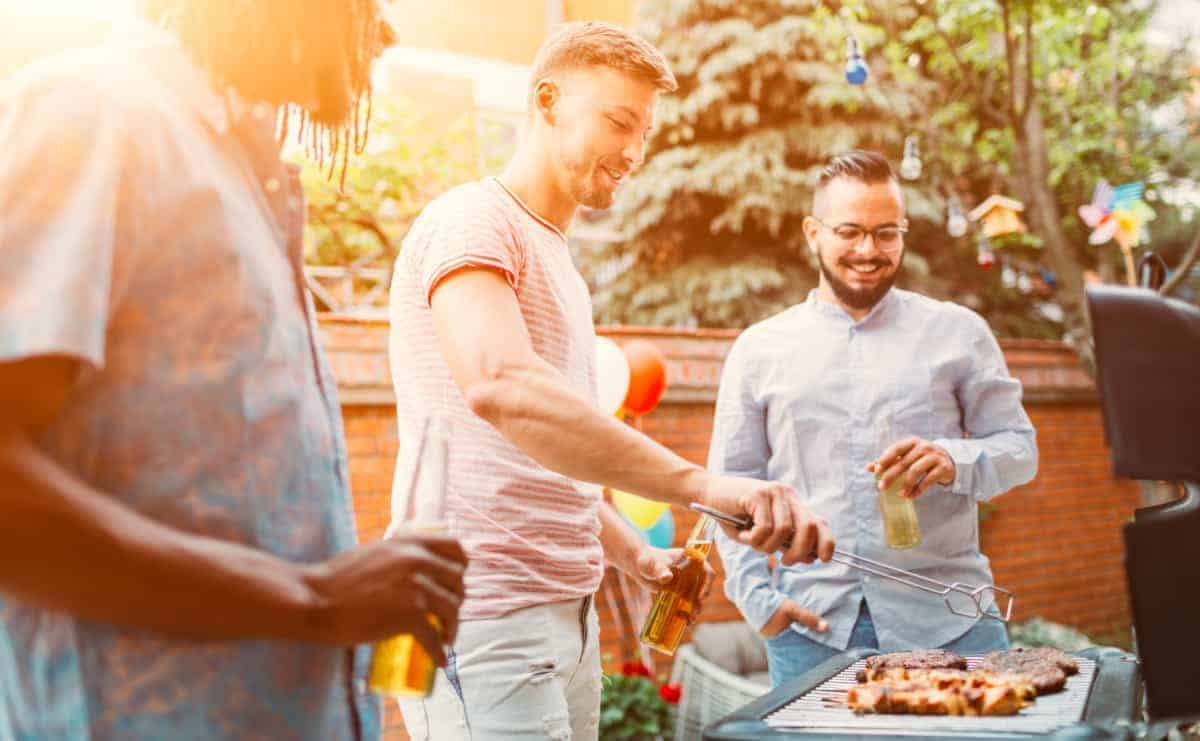 Guy friends barbecuing as a hobby