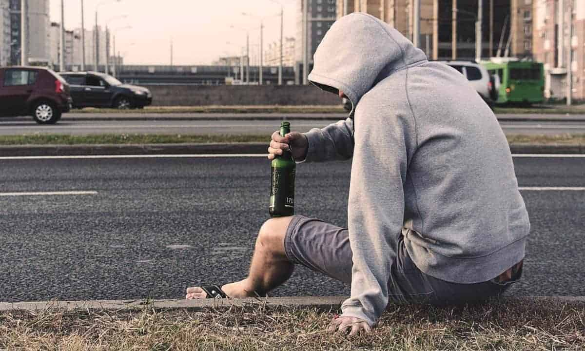 Suicidal Man Drinking by Street