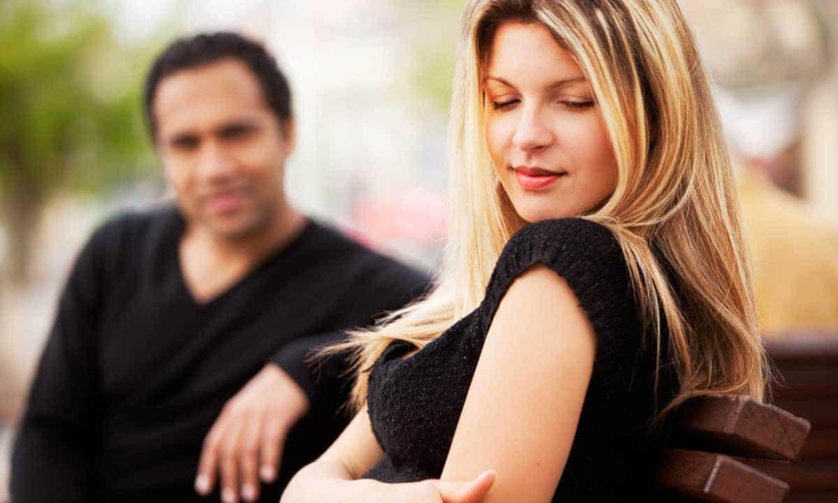 Man making woman blush.