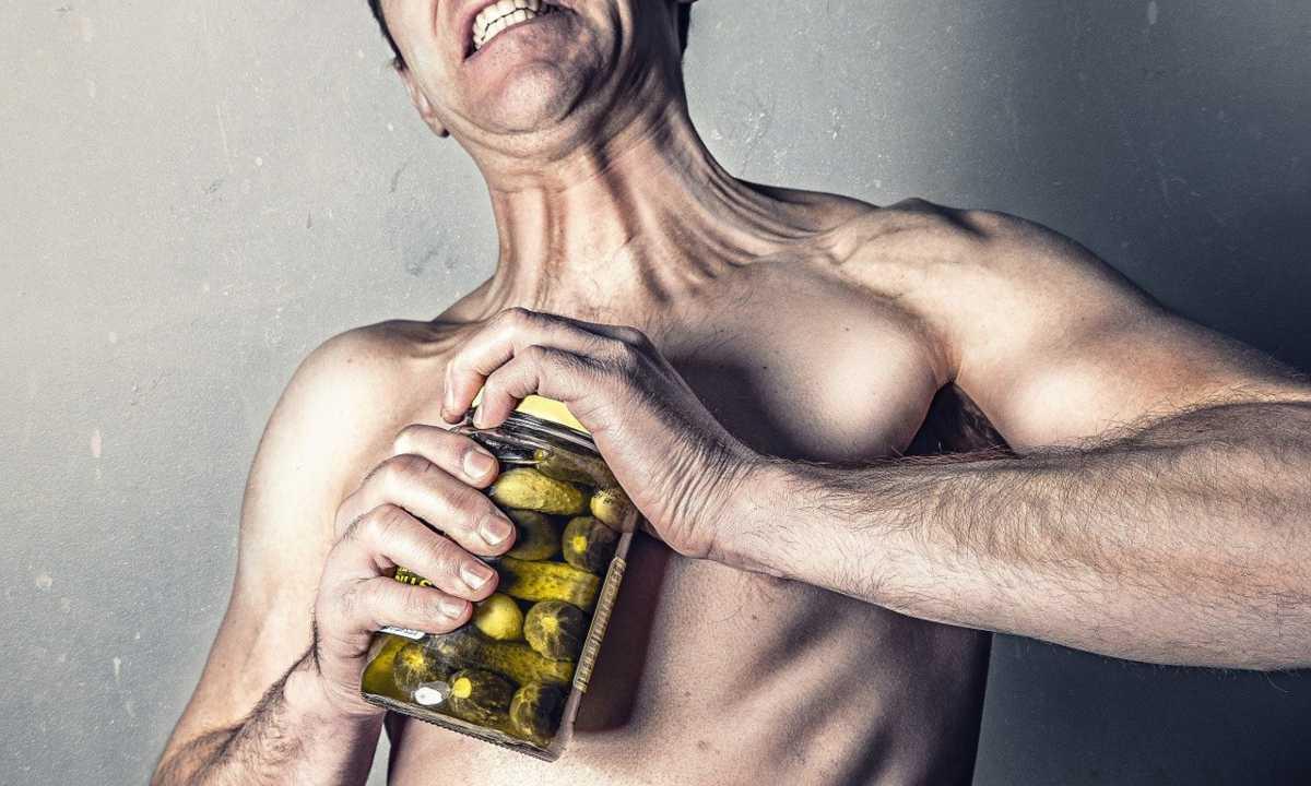 Weak man opening pickle jar