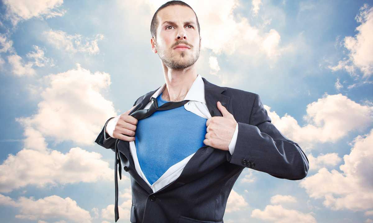 A confident man tearing his shirt apart like superman.