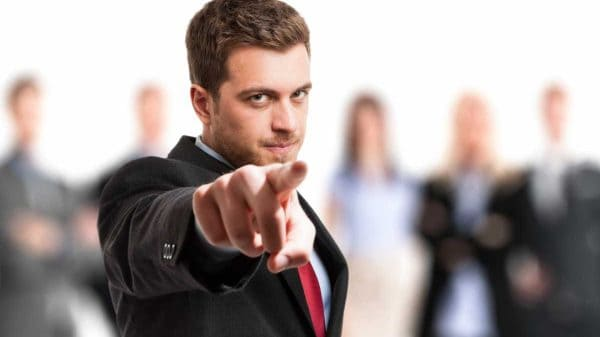 How to be confident - Suited Man Pointing Finger