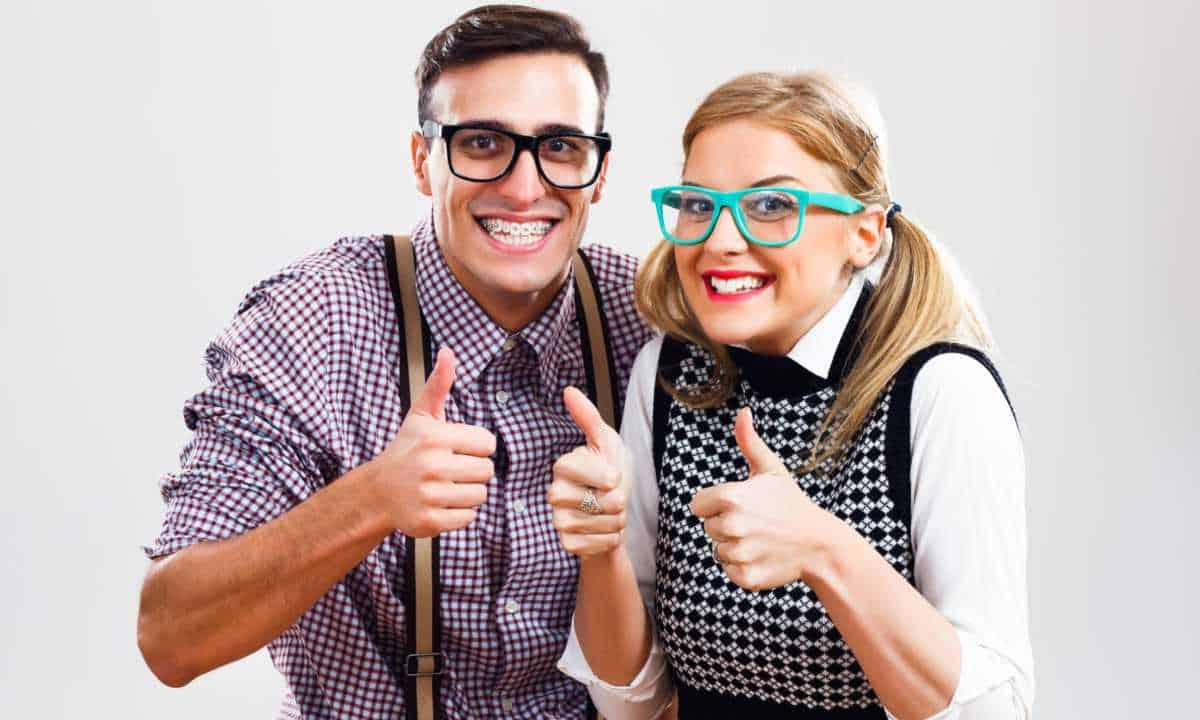 Nerdy Couple giving thumbs-up.